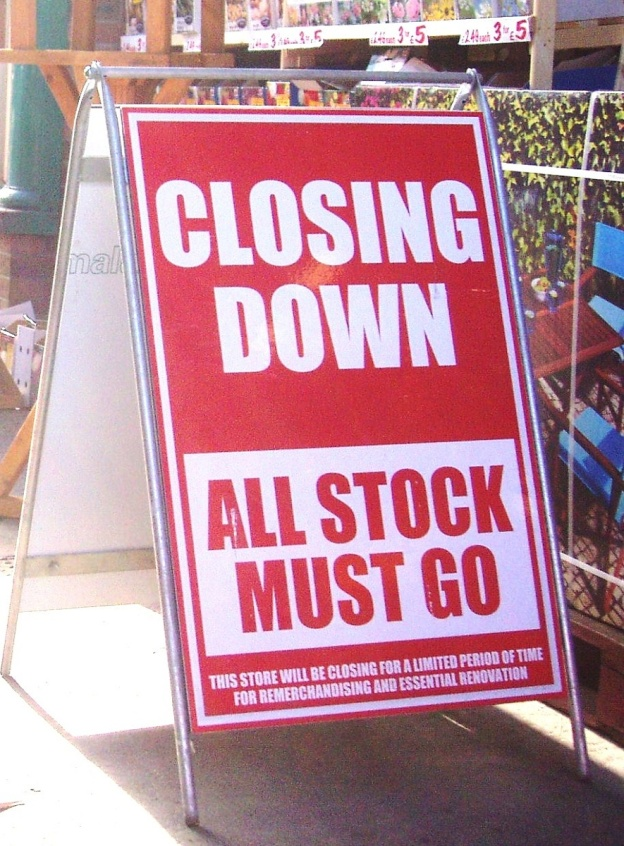 Image of a closing down sale board uotside a shop