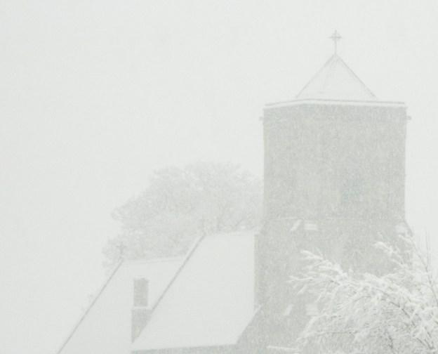 Church just visible through fog