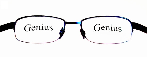 Image of pair of glasses with the word genius across each lens
