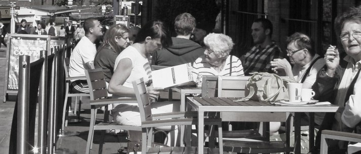 people outside a cafe
