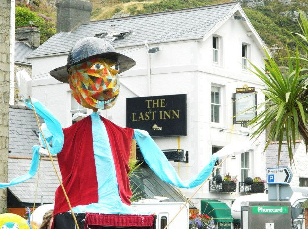 Giant puppet in front of Last Inn Barmouth