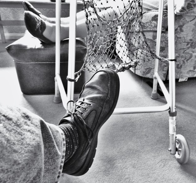 A man's foot with a old lady's feet in the background copyright Bernard Young